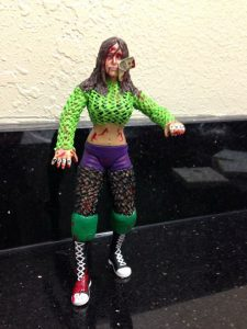 Kiki Rose custom figure complete with a dollar bill stapled to her face from Queen of the Deathmatches 2014