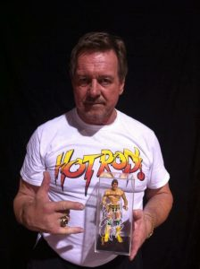 Roddy Piper with Anthony Mossow's figure in-hand