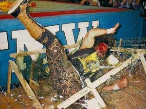 Cactus Jack going through a Caribbean spider web in FMW
